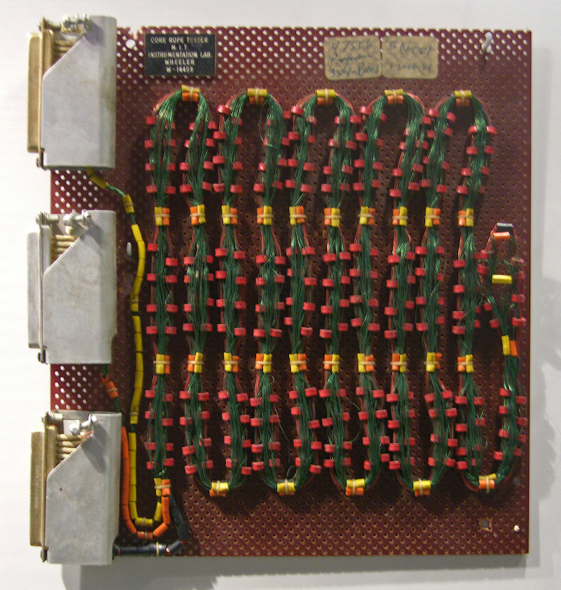 Image of a circuit board with green wire loops